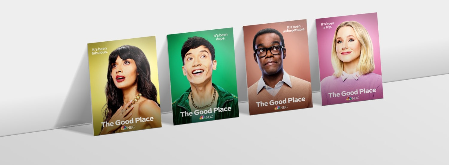 Characters from the Good Place on cards, leaning against a surface with perspective